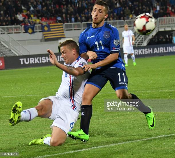 Kosovo's Donis Avdijaj vies with Iceland's Ragnar Sigurdsson during the FIFA World Cup 2018 qualification football match between Kosovo and Iceland...