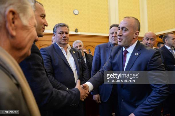 CORRECTION Kosovo's former Prime Minister Ramush Haradinaj arrives at the Court in Colmar eastern France on April 27 to hear the result of his...