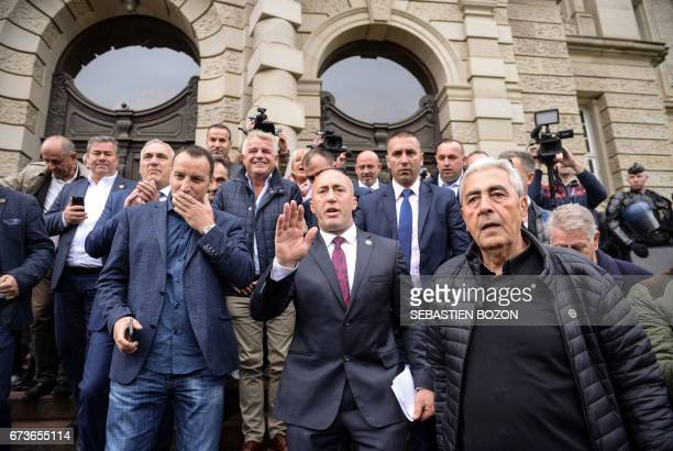 CORRECTION Kosovo's former Prime Minister Ramush Haradinaj gestures as he leaves the Court in Colmar eastern France on April 27 following the result...