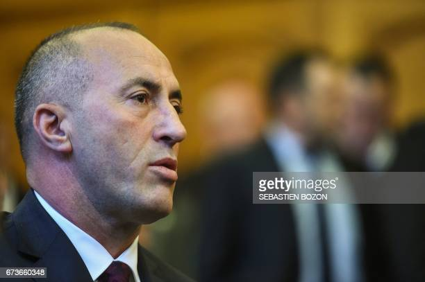 Kosovo's former Prime Minister Ramush Haradinaj sits in the side the Court in Colmar eastern France on April 27 as he waits to hear the result of his...