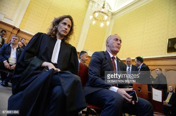 Kosovo's former Prime Minister Ramush Haradinaj sits next ot his lawyer Rachel Lindon inside the Court in Colmar eastern France on April 27 as he...