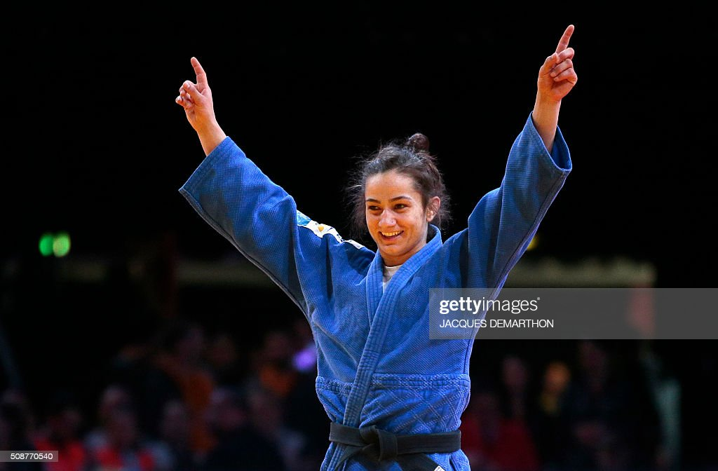 Kosovo's Majlinda Kelmendi celebrates beating Romania's Andreea Chitu in the women's under 52 kg final of the Paris Grand Slam Judo tournament on February 6, 2016 in Paris. / AFP / JACQUES DEMARTHON