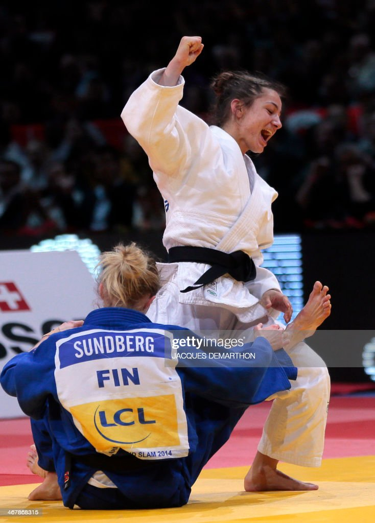 Kosovo's Majlinda Kelmendi celebrates her victory against Finland's Jaana Sundberg during the under 52kg finals at the2014 Paris Judo Grand Slam...