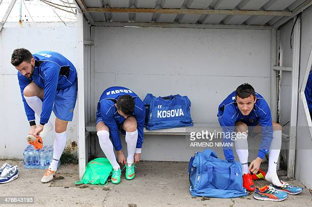 Kosovo's national football team players get ready to take part in a training session in Obilic on March 4 one day ahead of their first international...