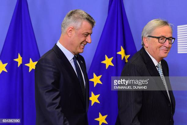 Kosovo's President Hashim Thaci is welcomed by European Commission President JeanClaude Juncker at the European Commission in Brussels on February 9...