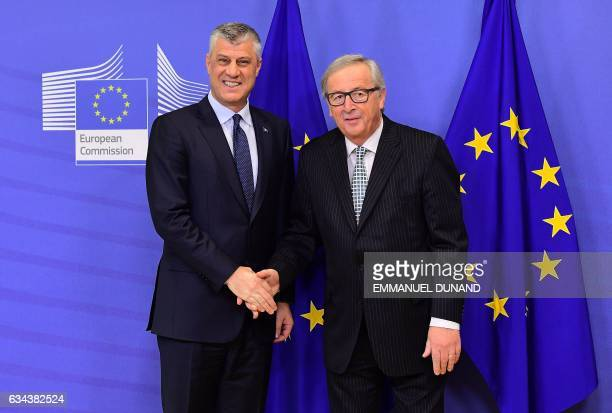 Kosovo's President Hashim Thaci shakes hands with European Commission President JeanClaude Juncker at the European Commission in Brussels on February...