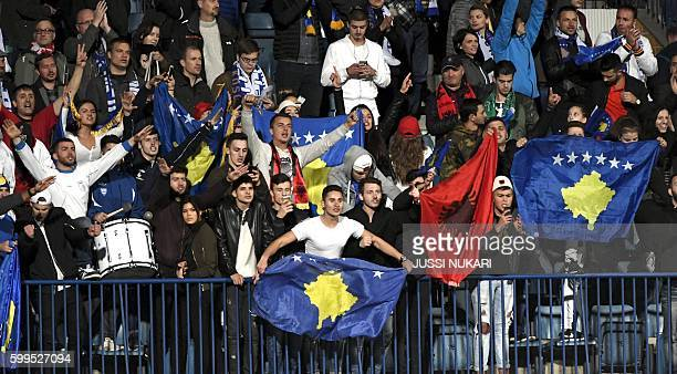 Kosovo's supporters celebrate at the end of the World Cup 2018 qualifying football match Finland vs Kosovo on September 5 2016 in Turku / AFP /...