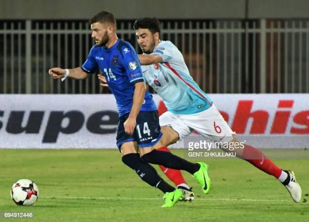 Kosovo's Valon Berisha is tackled by Turkey's Ozan Tufan during the FIFA World Cup 2018 qualification football match between Kosovo and Turkey at...