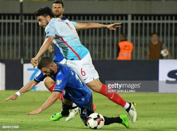 Kosovo's Valon Berisha is tackled by Turkey's Ozan Tufan during the FIFA World Cup 2018 qualification football match between Kosovo and Turkey at...