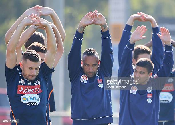 Kosta Barbarouses and Archie Thompson of the Victory stretch during a Melbourne Victory ALeague training session at Gosch's Paddock on April 17 2014...