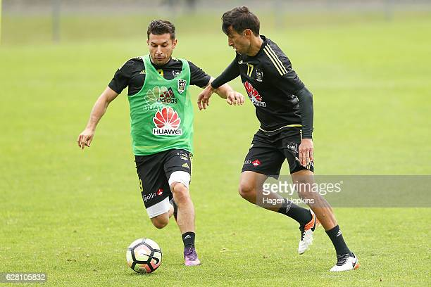 Kosta Barbarouses and Vince Lia compete for the ball during a Wellington Phoenix ALeague training session at Newtown Park on December 7 2016 in...
