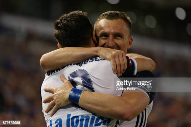 Kosta Barbarouses celebrates his goal with Besart Berisha of the Victory during the round eight ALeague match between the Newcastle Jets and the...
