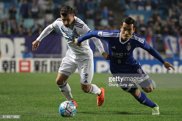 Kosta Barbarouses of Melbourne Victory competes for the ball with Cho WonHee of Suwon Samsung Bluewings FC during the AFC Champions League match...