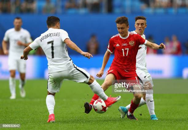Kosta Barbarouses of New Zealand and Aleksandr Golovin of Russia battle for possession during the FIFA Confederations Cup Russia 2017 Group A match...