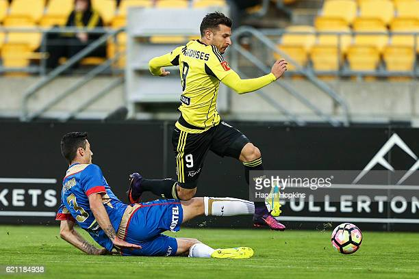 Kosta Barbarouses of the Phoenix is tackled by Jason Hoffman of the Jets during the round five ALeague match between the Wellington Phoenix and the...