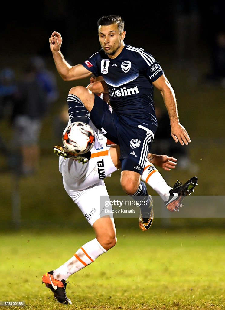 Kosta Barbarouses of the Victory and Jade North of the Roar challenge for the ball during the FFA Cup round of 32 match between the Brisbane Roar and the Melbourne Victory at Perry Park on August 9, 2017 in Brisbane, Australia.
