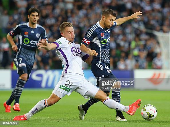 Kosta Barbarouses of the Victory and Scott Jamieson of the Glory compete for the ball during the round 20 ALeague match between Melbourne Victory and...