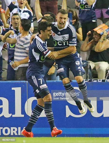 Kosta Barbarouses of the Victory celebrates with Gui Finkler after scoring a goal during the round 16 ALeague match between Melbourne Victory and...