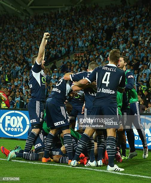 Kosta Barbarouses of the Victory celebrates with team mates after scoring a goal during the 2015 ALeague Grand Final match between the Melbourne...