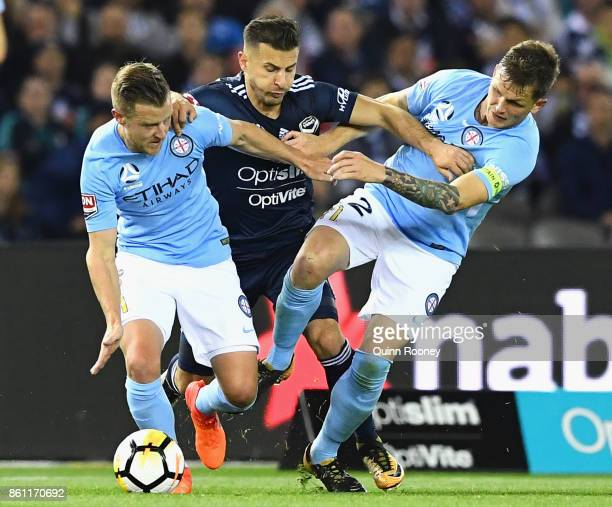 Kosta Barbarouses of the Victory competes for the ball against Scott Jamieson and Michael Jakobsen of the City during the round two ALeague match...