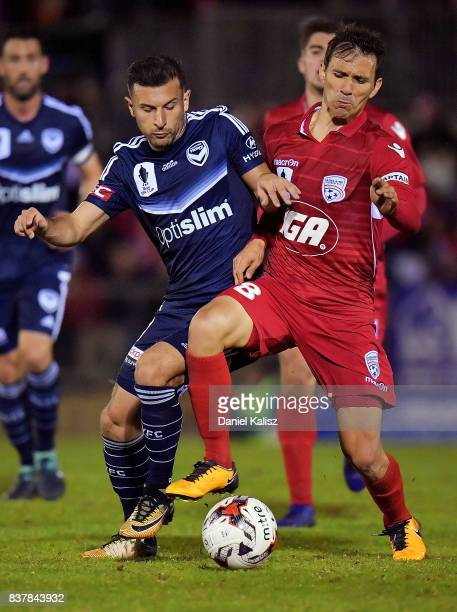 Kosta Barbarouses of the Victory competes for the ball with Isaas Sanchez of United during the round of 16 FFA Cup match between Adelaide United and...