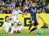 Kosta Barbarouses of the Victory controls the ball infront of Ku Jaryong of Suwon during the AFC Champions League match between the Melbourne Victory...