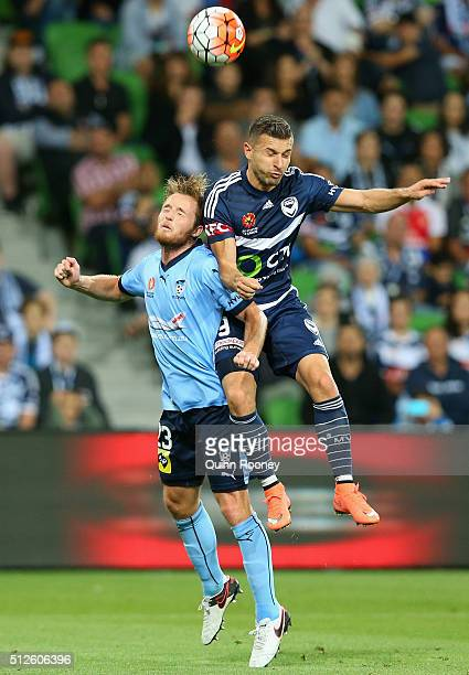 Kosta Barbarouses of the Victory heads the ball over the top of Rhyan Grant of Sydney FC during the round 21 ALeague match between Melbourne Victory...