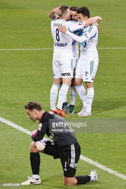 Kosta Barbarouses of the Victory is mobbed by Besart Berisha and Jesse Makarounas after kicking a goal during the FFA Cup Semi Final match between...