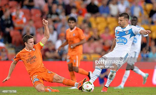 Kosta Barbarouses of the Victory is tackled by Matt McKay of the Roar during the round 18 ALeague match between the Brisbane Roar and Melbourne...