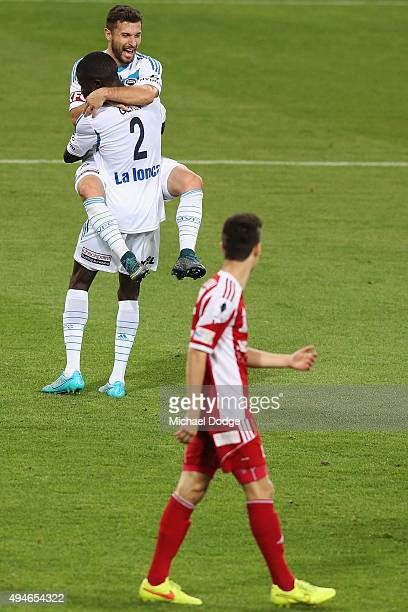 Kosta Barbarouses of the Victory jumps on Jason Geria after he kicked a goal during the FFA Cup Semi Final match between Hume City and Melbourne...