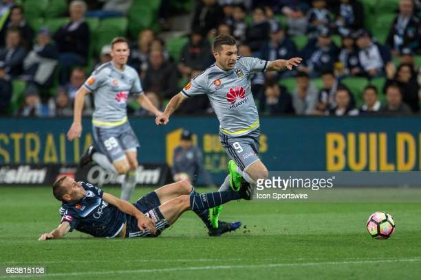 Kosta Barbarouses of the Wellington Phoenix and Alan Baro of Melbourne Victory contest the ball during the round 25 match of the Hyundai ALeague...
