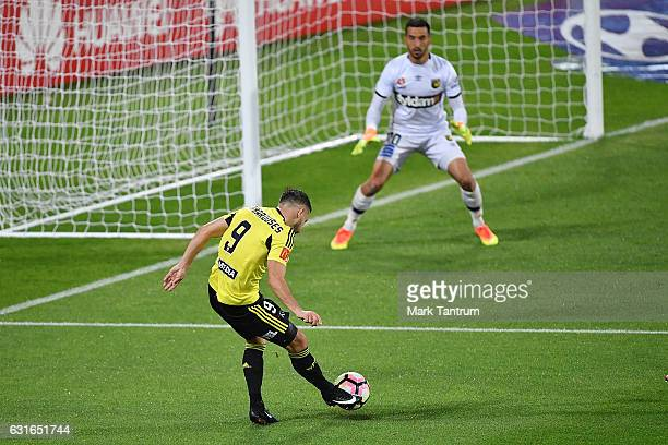 Kosta Barbarouses of the Wellington Phoenix attempts a goal with Paul Izzo of the Central Coast Mariners defending during the round 15 ALeague match...