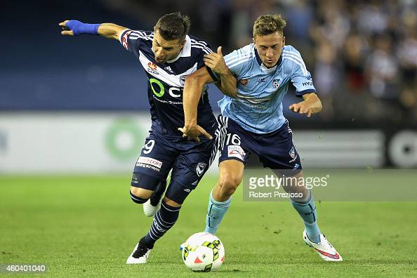 Kosta Barbarouses of Victory and Alexander Gersbach of Sydney contest the ball during the round 11 ALeague match between Melbourne Victory and Sydney...