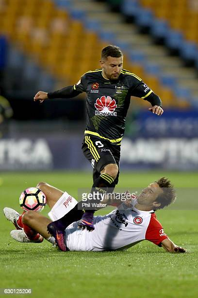 Kosta Barbarrouses of Wellington is tackled by Aritz Borda of Western Sydney during the round 11 ALeague match between Wellington and Western Sydney...