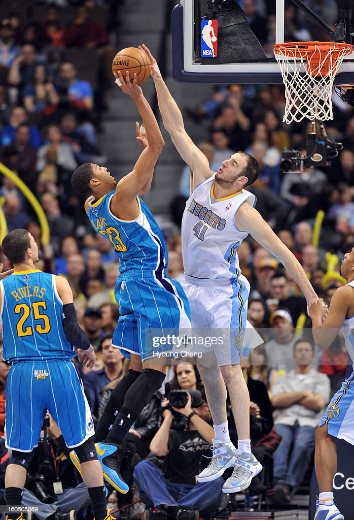 Kosta Koufos of Denver Nuggets #41 blocks the shot of Anthony Davis of New Orleans Hornets #23 in the 2nd half of the game on February 1, 2013 at Pepsi Center in Denver, Colorado. Denver won 113-98.