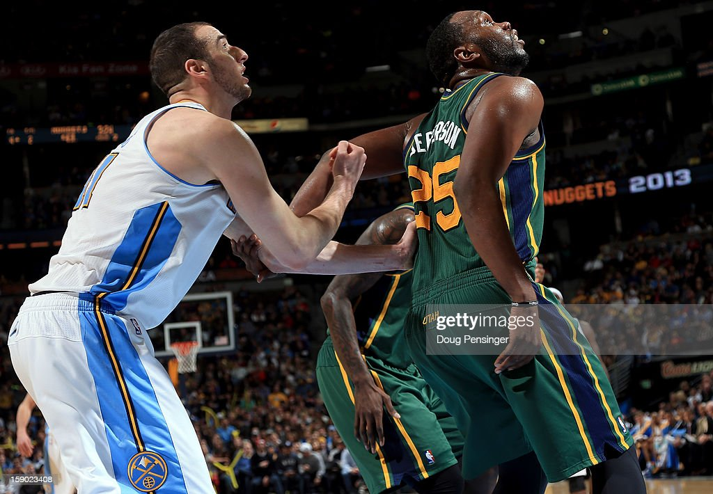 Kosta Koufos #41 of the Denver Nuggets and Al Jefferson #25 of the Utah Jazz battle for rebounding position at the Pepsi Center on January 5, 2013 in Denver, Colorado. The Nuggets defeated the Jazz 110-91.
