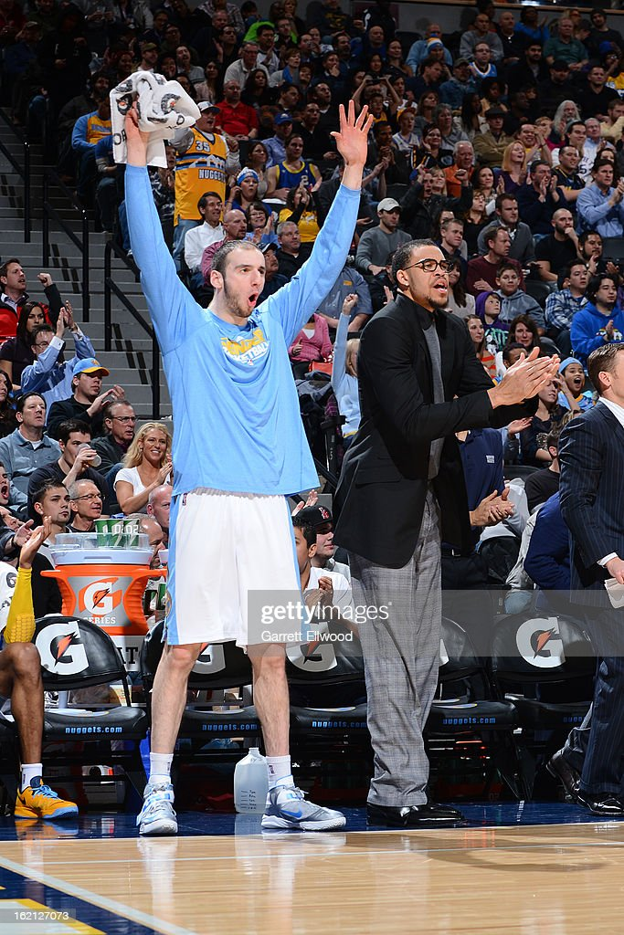 Kosta Koufos #41 of the Denver Nuggets cheers from the bench during the game against the Houston Rockets on January 30, 2013 at the Pepsi Center in Denver, Colorado.