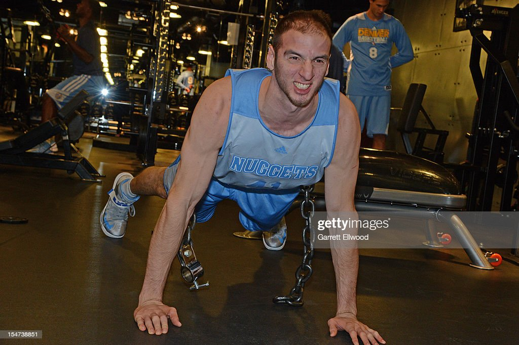 Kosta Koufos #41 of the Denver Nuggets does push ups during practice on October 24, 2012 at the Pepsi Center in Denver, Colorado.