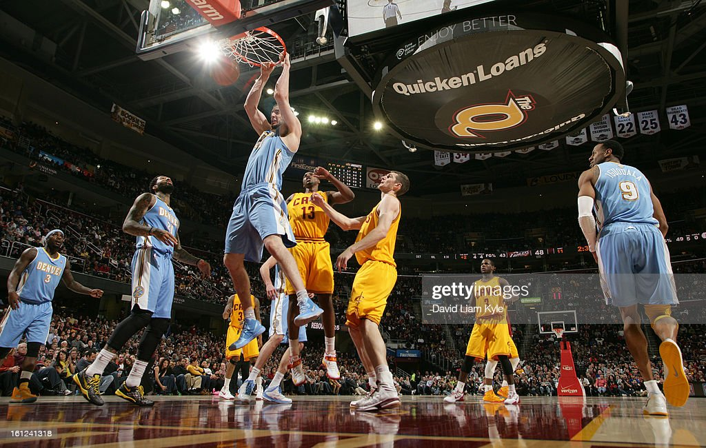Kosta Koufos #41 of the Denver Nuggets dunks the ball against Tristan Thompson #13 and Tyler Zeller #40 of the Cleveland Cavaliers at The Quicken Loans Arena on February 9, 2013 in Cleveland, Ohio.