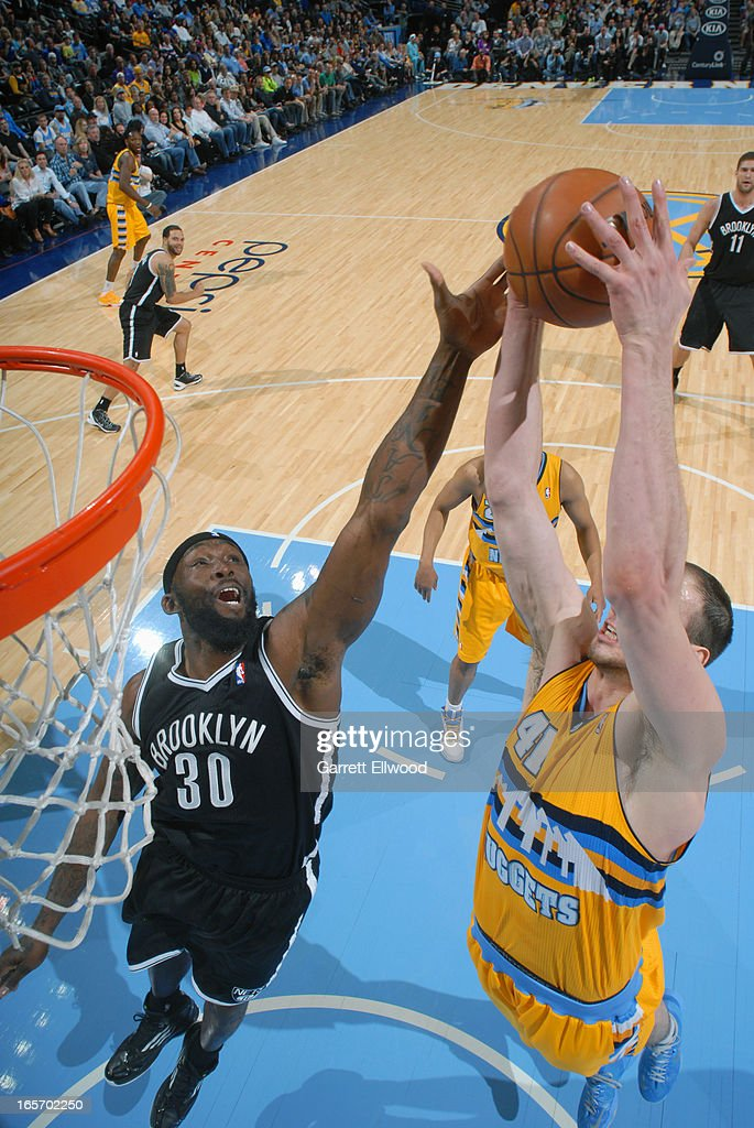 <a gi-track='captionPersonalityLinkClicked' href=/galleries/search?phrase=Kosta+Koufos&family=editorial&specificpeople=4216032 ng-click='$event.stopPropagation()'>Kosta Koufos</a> #41 of the Denver Nuggets grabs a rebound against the Brooklyn Nets on March 29, 2013 at the Pepsi Center in Denver, Colorado.
