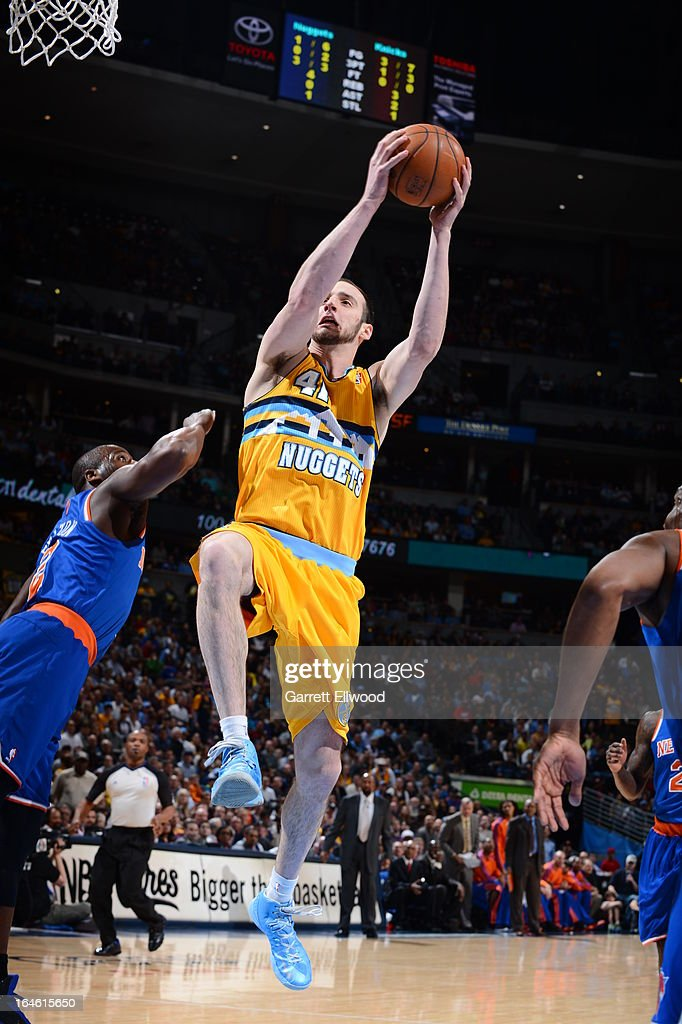 <a gi-track='captionPersonalityLinkClicked' href=/galleries/search?phrase=Kosta+Koufos&family=editorial&specificpeople=4216032 ng-click='$event.stopPropagation()'>Kosta Koufos</a> #41 of the Denver Nuggets grabs a rebound against the New York Knicks on March 13, 2013 at the Pepsi Center in Denver, Colorado.