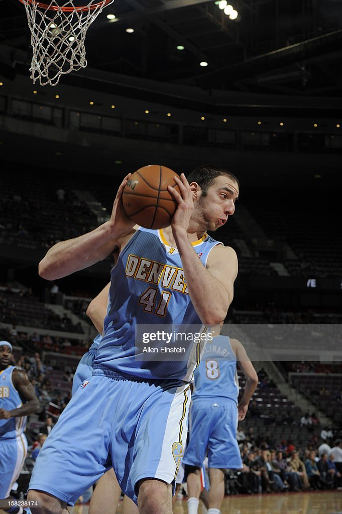 Kosta Koufos #41 of the Denver Nuggets grabs a rebound against the Detroit Pistons during the game on December 11, 2012 at The Palace of Auburn Hills in Auburn Hills, Michigan.