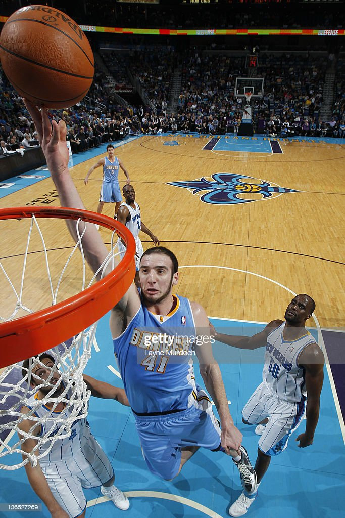 <a gi-track='captionPersonalityLinkClicked' href=/galleries/search?phrase=Kosta+Koufos&family=editorial&specificpeople=4216032 ng-click='$event.stopPropagation()'>Kosta Koufos</a> #41 of the Denver Nuggets lays the ball up during an NBA game between the Denver Nuggets and the New Orleans Hornets on January 6, 2012 at the New Orleans Arena in New Orleans, Louisiana.