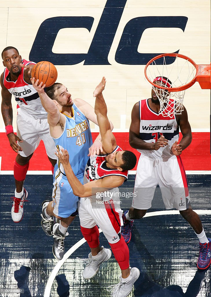 <a gi-track='captionPersonalityLinkClicked' href=/galleries/search?phrase=Kosta+Koufos&family=editorial&specificpeople=4216032 ng-click='$event.stopPropagation()'>Kosta Koufos</a> #41 of the Denver Nuggets shoots against <a gi-track='captionPersonalityLinkClicked' href=/galleries/search?phrase=JaVale+McGee&family=editorial&specificpeople=4195625 ng-click='$event.stopPropagation()'>JaVale McGee</a> #34 of the Washington Wizards during the game at the Verizon Center on January 20, 2012 in Washington, DC.