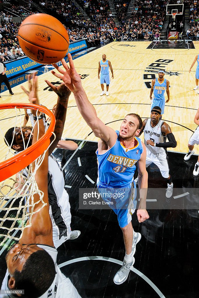 <a gi-track='captionPersonalityLinkClicked' href=/galleries/search?phrase=Kosta+Koufos&family=editorial&specificpeople=4216032 ng-click='$event.stopPropagation()'>Kosta Koufos</a> #41 of the Denver Nuggets shoots against the San Antonio Spurs during a pre-season game on October 12, 2012 at the AT&T Center in San Antonio, Texas.