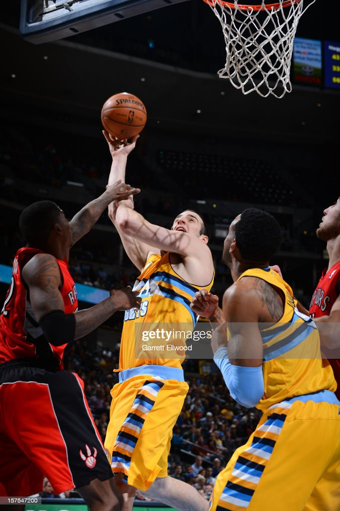 <a gi-track='captionPersonalityLinkClicked' href=/galleries/search?phrase=Kosta+Koufos&family=editorial&specificpeople=4216032 ng-click='$event.stopPropagation()'>Kosta Koufos</a> #41 of the Denver Nuggets shoots the ball against the Toronto Raptors on December 3, 2012 at the Pepsi Center in Denver, Colorado.