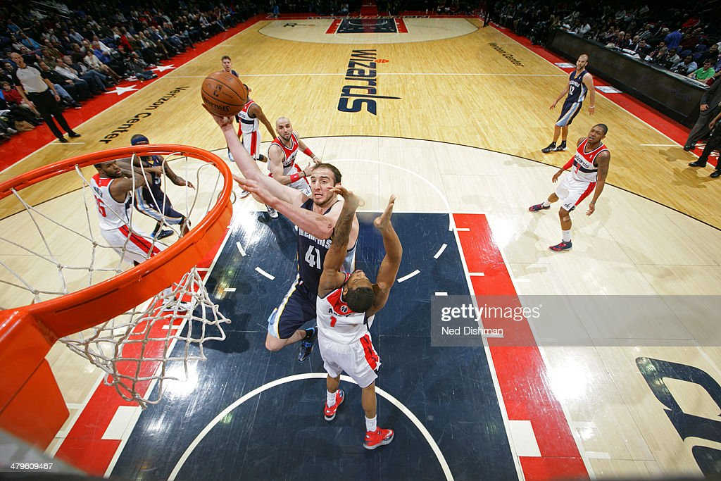 <a gi-track='captionPersonalityLinkClicked' href=/galleries/search?phrase=Kosta+Koufos&family=editorial&specificpeople=4216032 ng-click='$event.stopPropagation()'>Kosta Koufos</a> #41 of the Memphis Grizzlies shoots against the Washington Wizards at the Verizon Center on March 3, 2014 in Washington, DC.