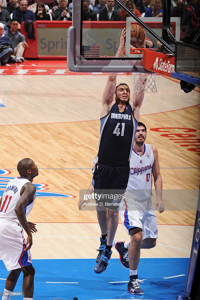 <a gi-track='captionPersonalityLinkClicked' href=/galleries/search?phrase=Kosta+Koufos&family=editorial&specificpeople=4216032 ng-click='$event.stopPropagation()'>Kosta Koufos</a> #41 of the Memphis Grizzlies throws down a dunk in a game against the Los Angeles Clippers at Staples Center on November 18, 2013 in Los Angeles, California.
