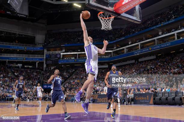 Kosta Koufos of the Sacramento Kings goes up for a dunk during a game against the Memphis Grizzlies on March 27 2017 at Golden 1 Center in Sacramento...