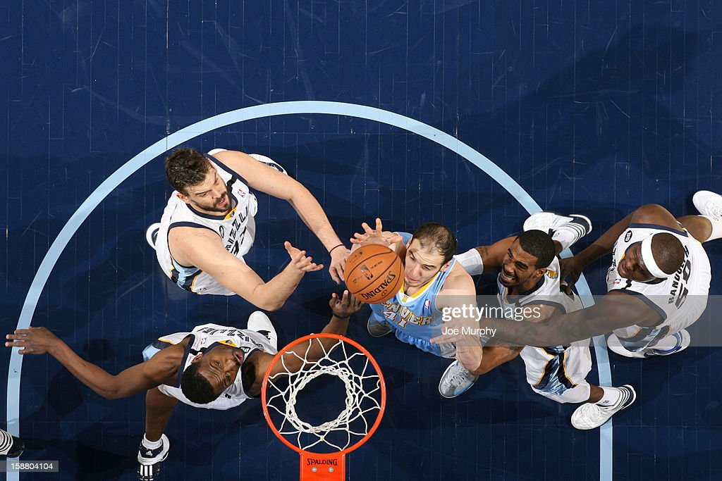 Kosta Koufos #41of the Denver Nuggets rebound against Tony Allen #9, Marc Gasol #33, Mike Conley #11 and Zach Randolph #50 of the Memphis Grizzlies on December 29, 2012 at FedExForum in Memphis, Tennessee.